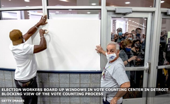 Election workers board up windows thereby blocking view of the vote counting process