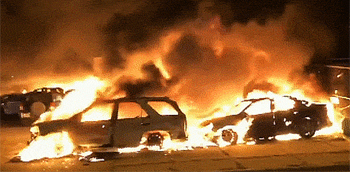 Wisconsin car dealership goes up in flames with 140 cars torched by angry mob